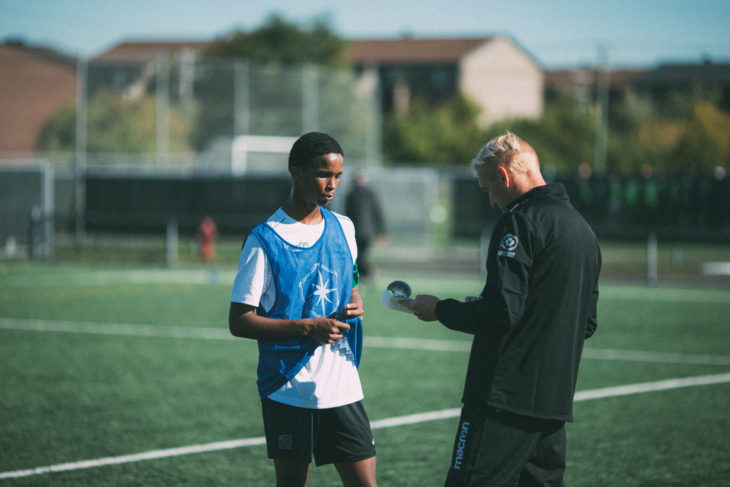 Hamdi Djama chats with Valour FC coach Rob Gale during Day 1 of the CPL's Open Trials. (Lucho Calderon/CPL)