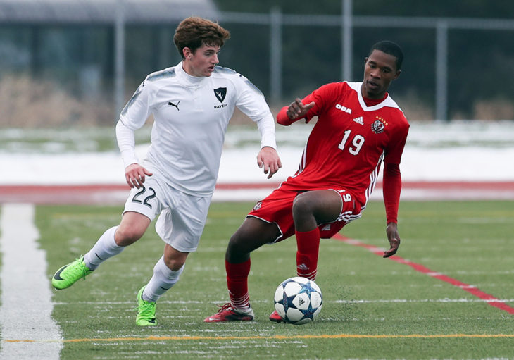 Players from Carleton, York battle for the ball.