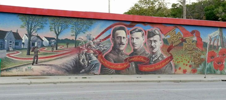The mural on the corner of Ellice Avenue and Valour Road featuring the three soldiers from Pine Street (now known as Valour Road) — Cpl. Leo Clarke, Sgt.-Maj. Frederick William Hall, and Lt. Robert Shanklin — who were awarded the Victoria Cross. (SUPPLIED/CHRISTINA HIEBERT/THE METRO/CANSTAR)