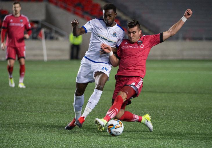 FC Edmonton's Tomi Ameobi (L). (Canada Soccer)