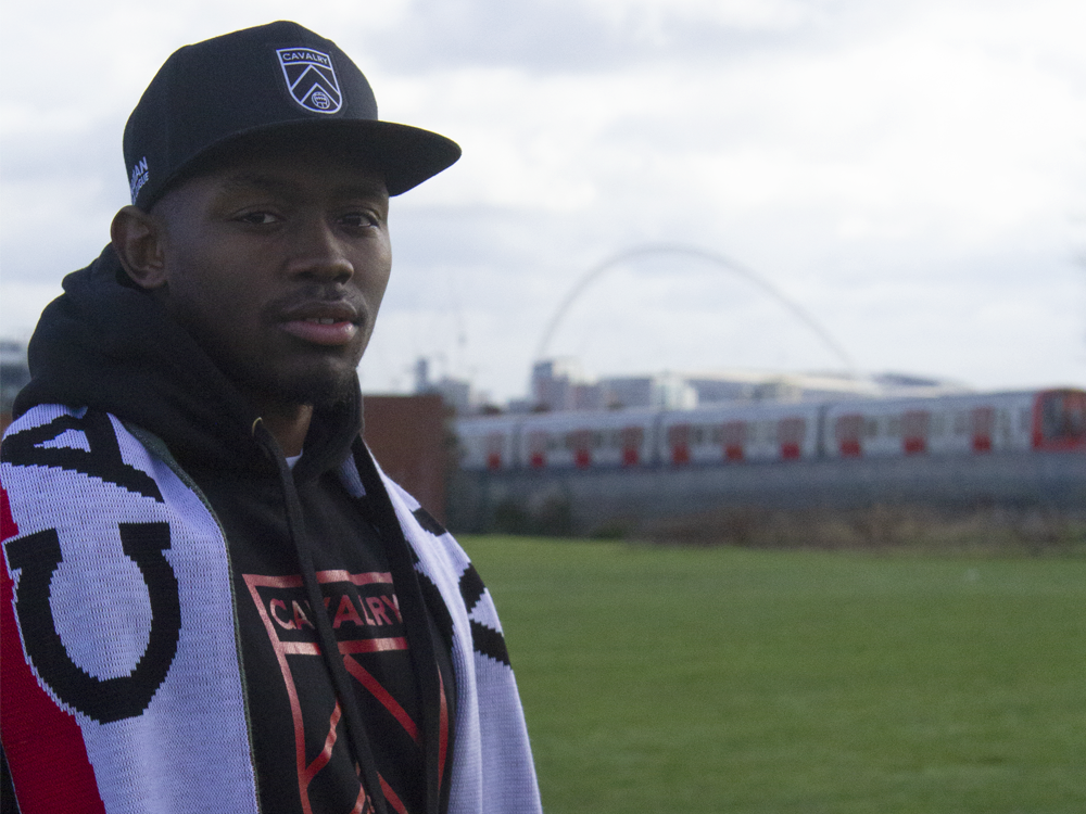 Cavalry FC's latest signing Jordan Brown in front of England's iconic Wembley Stadium.