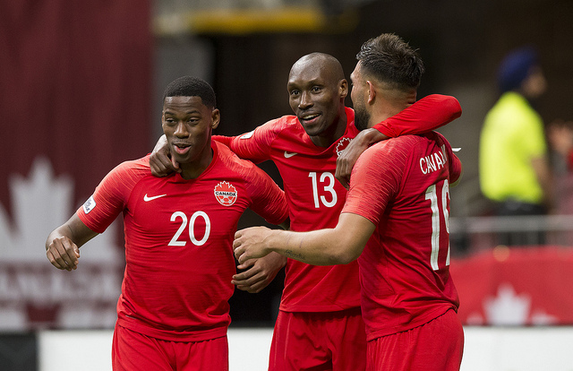 (L to R) Jonathan David, Atiba Hutchinson and Lucas Cavallini celebrate a goal during Nations League qualifying. (Canada Soccer)