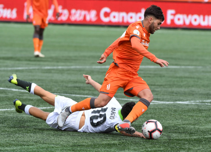 Forge midfielder Tristan Borges dribbles the ball past York9's Manny Aparicio in the second half of the CPL's inaugural match at Tim Hortons Field. (Dan Hamilton-USA TODAY Sports for CPL)