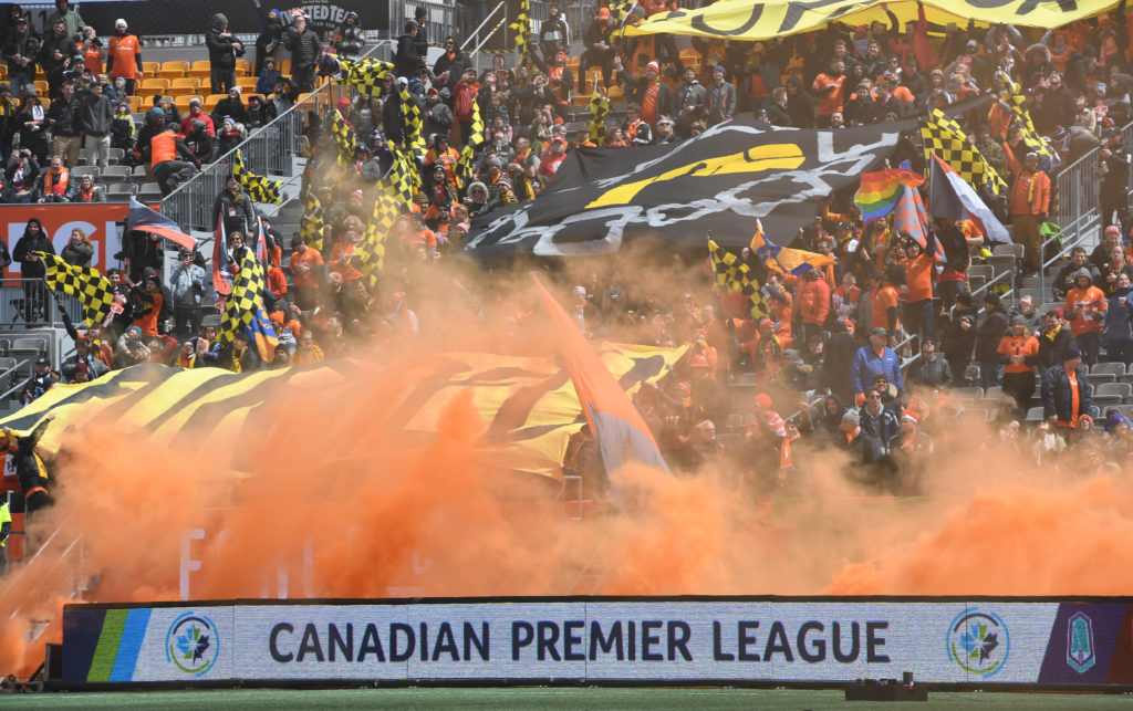 Forge fans set off smoke and display banners prior to kickoff against York9 in the inaugural Canadian Premier League match at Tim Hortons Field. (Dan Hamilton-USA TODAY Sports for CPL)