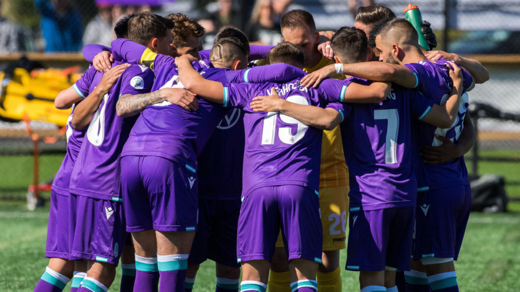Pacific FC players huddle before playing their first Canadian Premier League match. (James MacDonald/CPL).
