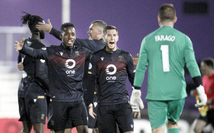 Jordan Murrell, Louis Béland-Goyette and Tyson Farago celebrate Valour FC's first win. (Kevin Light/CPL)