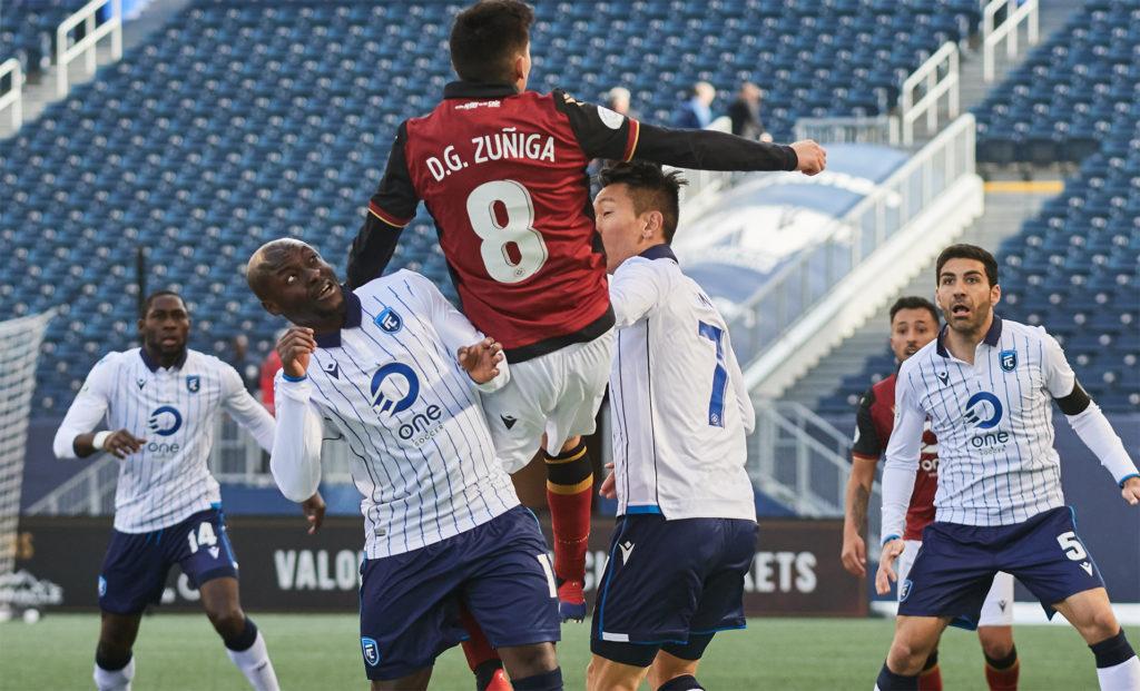 FC Edmonton's Randy Edwini-Bonsu challenges for the ball against Valour FC. (Photo: Valour FC).