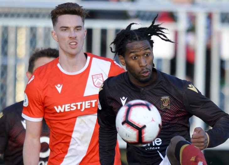 Canadian Premier League - Cavalry FC v Valour FC - Calgary, Alberta, Canada May 8, 2019 Joel Waterman (15) of Cavalry FC and Ali Musse of Valour FC close in on the ball. Mike Sturk/CPL
