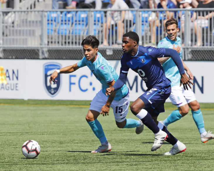 May 12, 2019; Edmonton, Alberta, CAN;  Pacific FC attacker Jose Hernandez (15) and FC Edmonton defender Kareem Moses (12) chase after a loose ball during a Canadian Premier League soccer match at Clarke Stadium. Mandatory Credit: Perry Nelson-USA TODAY Sports for CPL