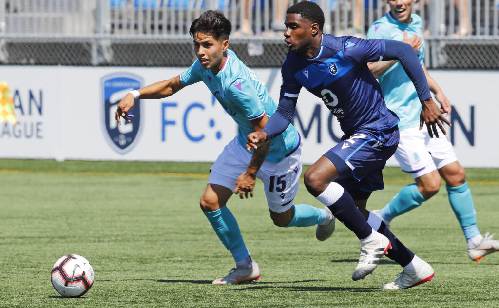 Pacific FC attacker Jose Hernandez and FC Edmonton defender Kareem Moses chase after a loose ball during a CPL match at Clarke Stadium. (Perry Nelson-USA TODAY Sports for CPL).