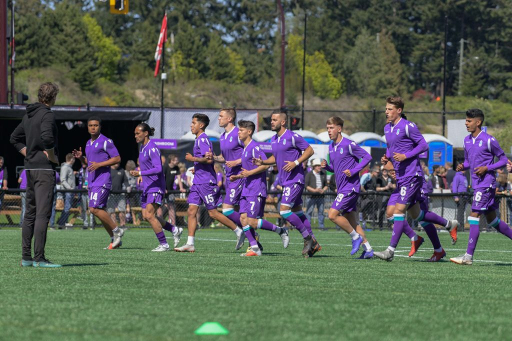 Pacific FC players take part in warmups ahead of a match at Westhills Stadium. (Pacific FC)