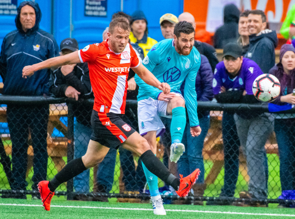 Cavs' Nico Pasquotti battles for the ball with Pacific's Blake Smith. (Pacific FC)