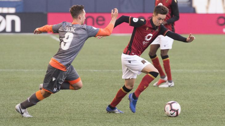 Valour's Raphael Garcia moves past Forge FC striker Marcel Zajac. (CPL).