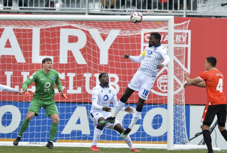 Canadian Premier League - Cavalry FC v FC Edmonton - Calgary, Alberta, Canada May 18, 2019 Tomi Ameobi of FC Edmonton heads the ball out of harmÕs way in front ofthe goal. Mike Sturk/CPL