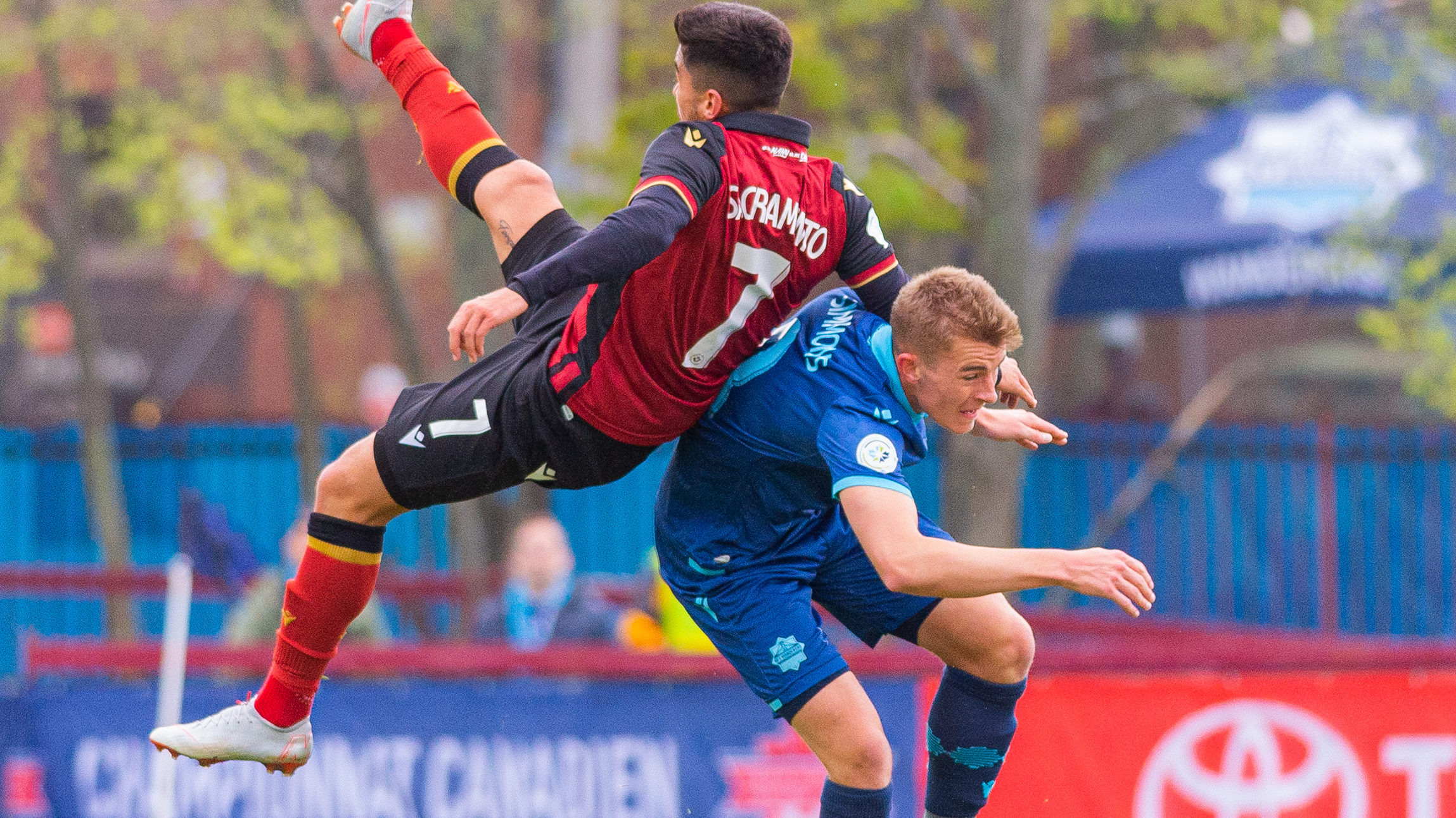 Valour FC's Dylan Sacramento and HFX Wanderers FC's Elliott Simmons collide in their Canadian Championship second round, first leg tilt. (Trevor MacMillan/CPL).