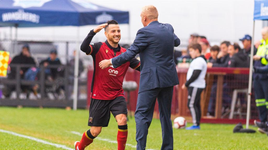 Valour FC midfielder Marco Bustos celebrates a goal with Valour head coach Rob Gale. (Trevor MacMillan/CPL).