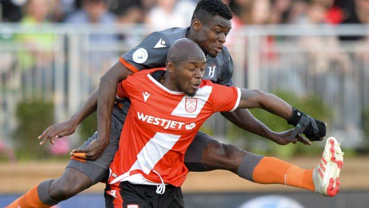 Bertrand Owundi of Forge FC tackles Jordan Brown of Cavalry FC. (Mike Sturk/CPL).