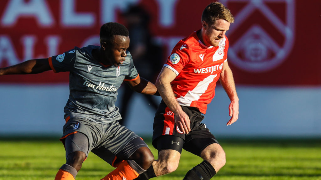 Cavalry FC defender Dean Northover and Forge FC midfielder Kwame Awuah battle for the ball in the first half of a Canadian Championship match at Spruce Meadows. (Sergei Belski-USA TODAY Sports for CPL)