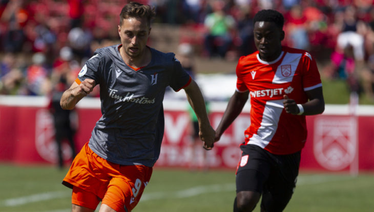 Cavalry FC's Nathan Mavia chases down Forge FC's Marcel Zajac. (Tony Lewis/CPL).
