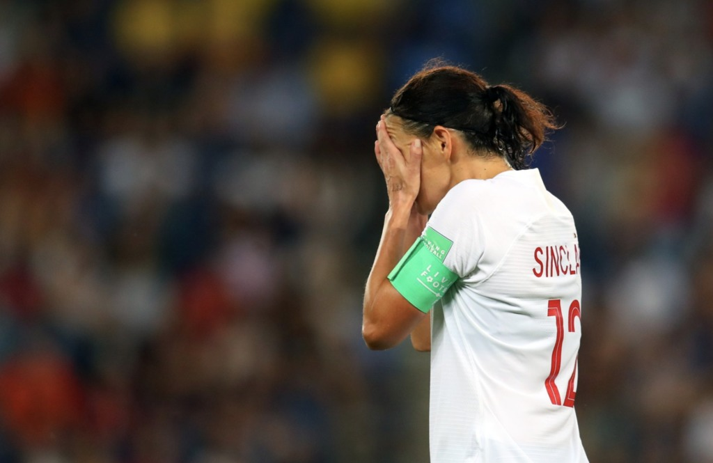 Christine Sinclair with her head in her hands following a 1-0 loss to Sweden in World Cup action.