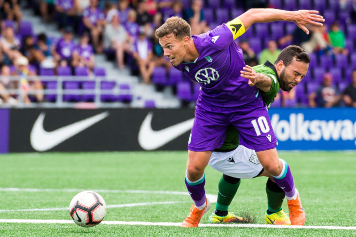Pacific's Ben Fisk battles for the battle against Cavalry FC's Sergio Camargo at Westhills Stadium. (Photo: Pacific FC/Reuters).