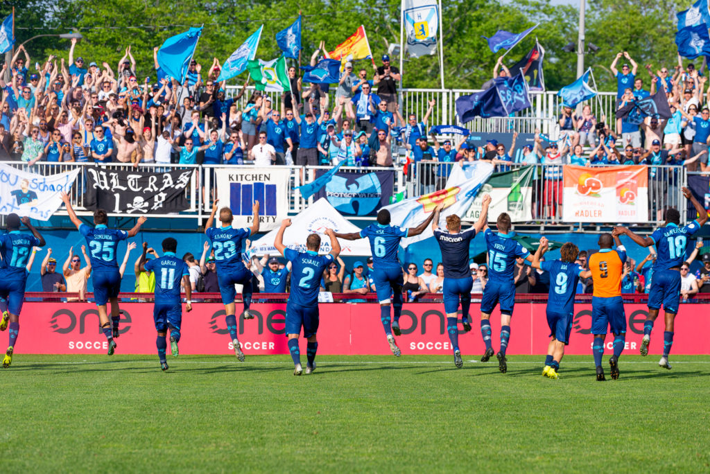 HFX players celebrate with fans in Halifax. (Trevor MacMillan/CPL)