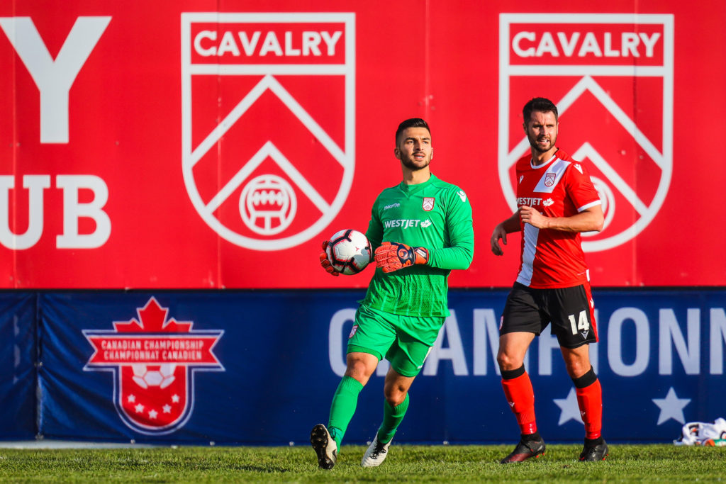 Cavalry FC goalkeeper Marco Carducci controls the ball against the Vancouver Whitecaps during the first half during a Canadian Championship soccer match at Spruce Meadows. (Photo: Sergei Belski-USA TODAY Sports for CPL).