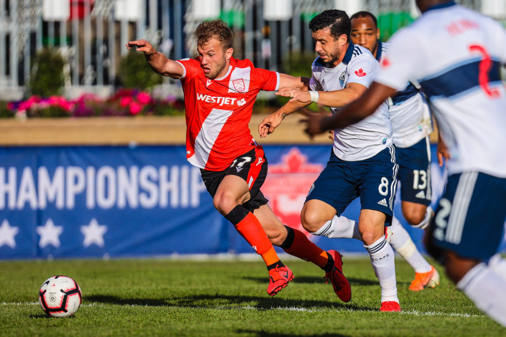 Cavalry FC attacker Nico Pasquotti (17) and Vancouver Whitecaps midfielder Felipe Martins (8) battle for the ball during the first half during a Canadian Championship soccer match at Spruce Meadows. Mandatory Credit: Sergei Belski-USA TODAY Sports for CPL