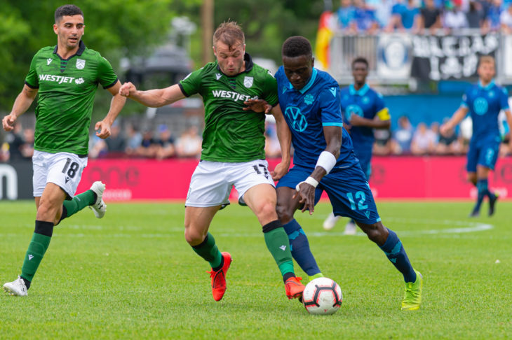 Cavalry FC's Nico Pasquotti and HFX Wanderers FC midfielder Mohammad Kourouma battle for a ball. (Trevor MacMillan/CPL).