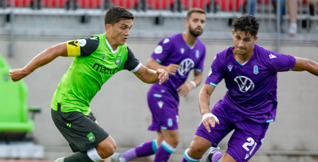 Manny Aparicio of York9 takes on Pacific FC defenders ahead of his goal. (Photo by Nora Stankovic).