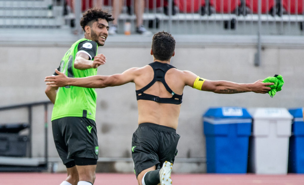 Manny Aparicio celebrates his team's opening goal against Pacific FC by taking his shirt off, drawing a yellow card. (Photo: Nora Stankovic).