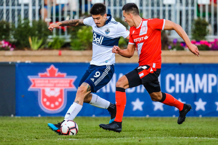 Jul 10, 2019; Calgary, Alberta, USA; Vancouver Whitecaps forward Joaquin Ardaiz (9) and Cavalry FC defender Dominick Zator (4) battle for the ball during the second half of a Canadian Championship soccer match at Spruce Meadows. Mandatory Credit: Sergei Belski-USA TODAY Sports for CPL