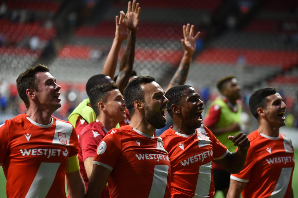 Jul 24, 2019; Vancouver, British Columbia, Canada; The Cavalry FC celebrate the win over the Vancouver Whitecaps during the second half at BC Place Stadium. Mandatory Credit: Anne-Marie Sorvin-USA TODAY Sports