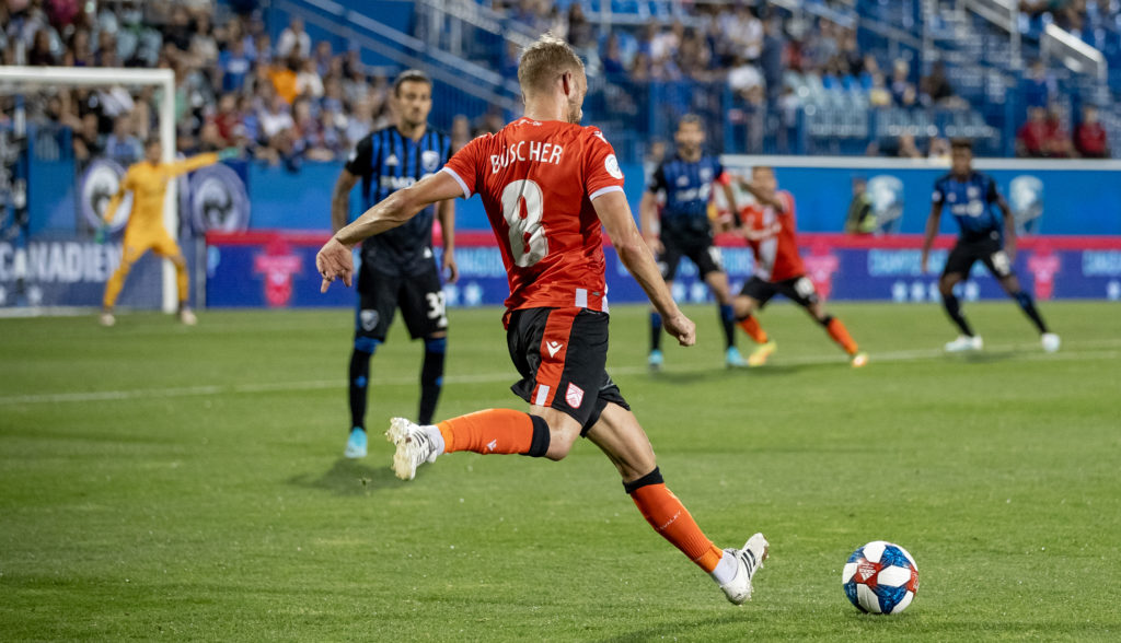 Cavalry's Julian Buscher takes on Montreal Impact in Canadian Championship action. (Photo: Nora Stankovic).