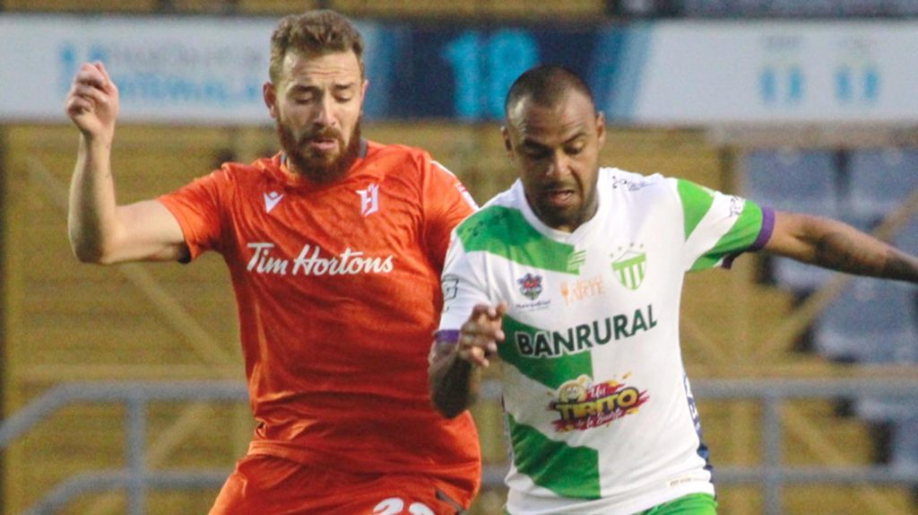 Forge FC's Anthony Novak battles for the ball against Antigua GFC in CONCACAF League play. (CONCACAF).