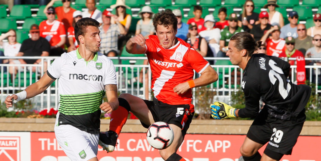 Cavalry battles for the ball vs. York9 FC at Spruce Meadows. (Photo: Tony Lewis/CPL).