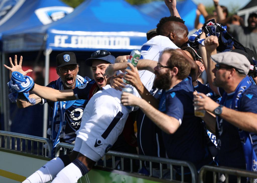 FC Edmonton's Omuar Diuock dives into the crowd at Clarke Stadium after scoring the opening goal against York9 FC. (Ian Kucerak/FC Edmonton)