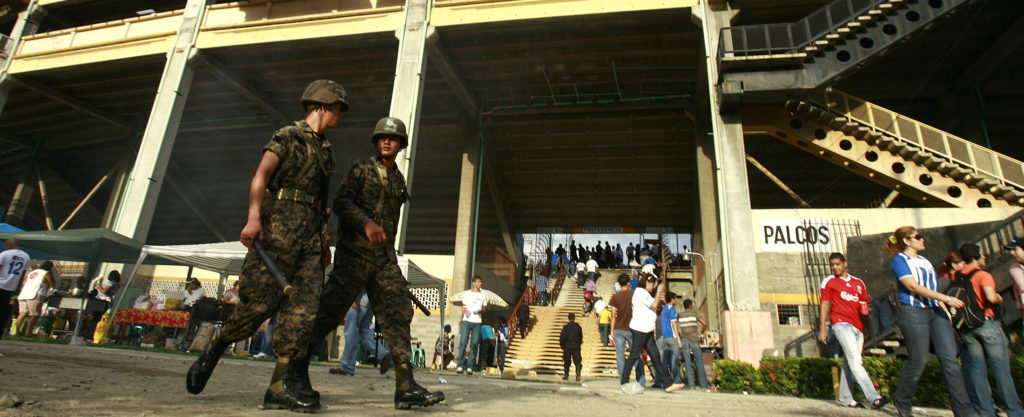 Soldiers patrol outside the Olimpic Metropolitano stadium before the 2010 World Cup qualifier soccer match between Honduras and Costa Rica in San Pedro Sula August 12, 2009. REUTERS/Juan Carlos Ulate (HONDURAS SPORT SOCCER MILITARY)