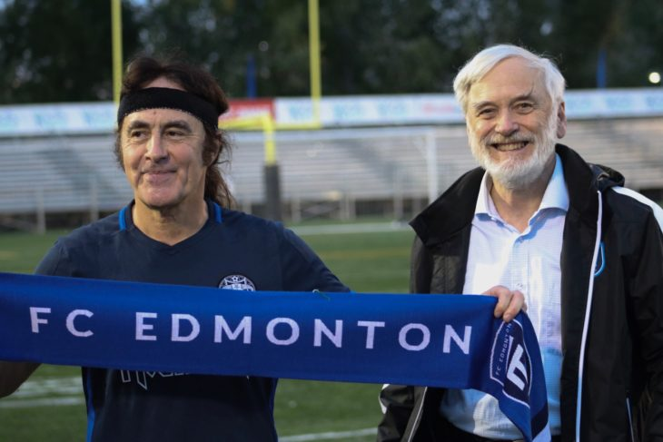 Iron Maiden bassist Steve Harris , left, with FC Edmonton owner Tom Fath. Photo by Codie McLachlan