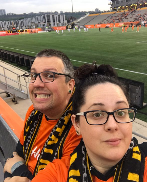 Stephanie and her husband Craig at a Forge FC home game.