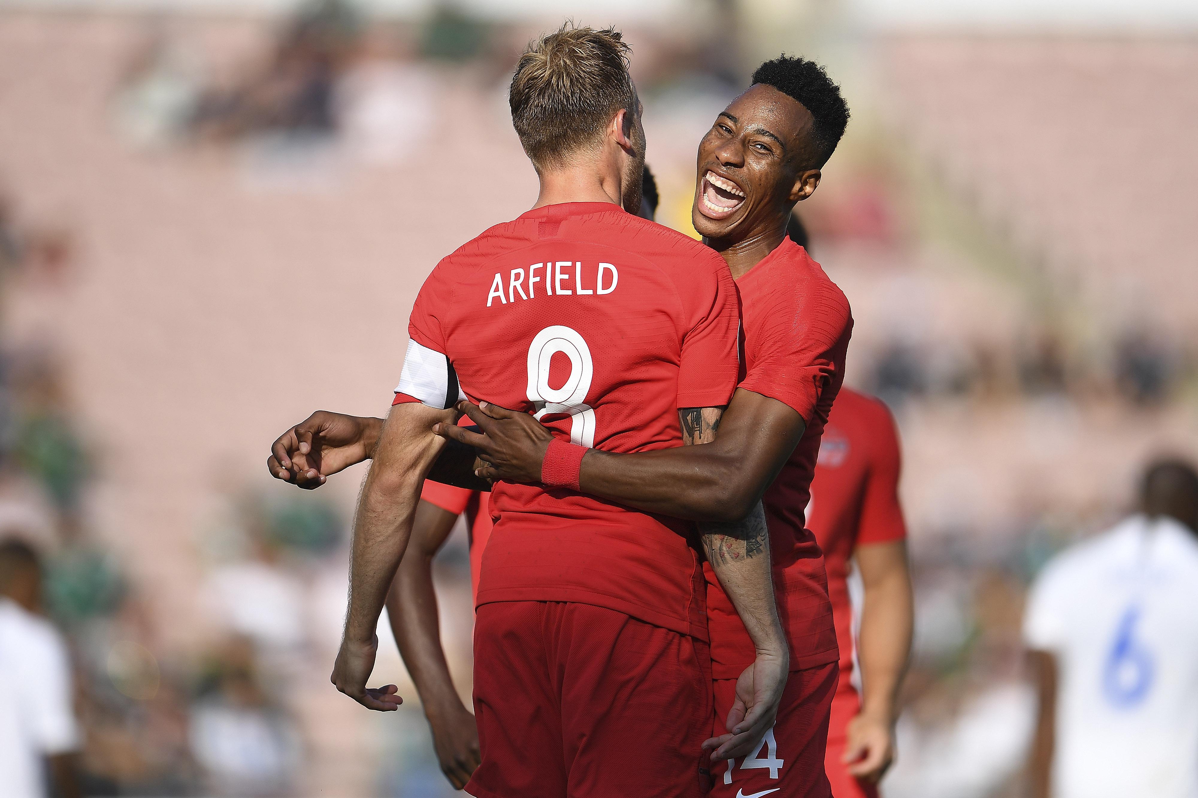Mark-Anthony Kaye celebrates with Scott Arfield. (Canada Soccer).