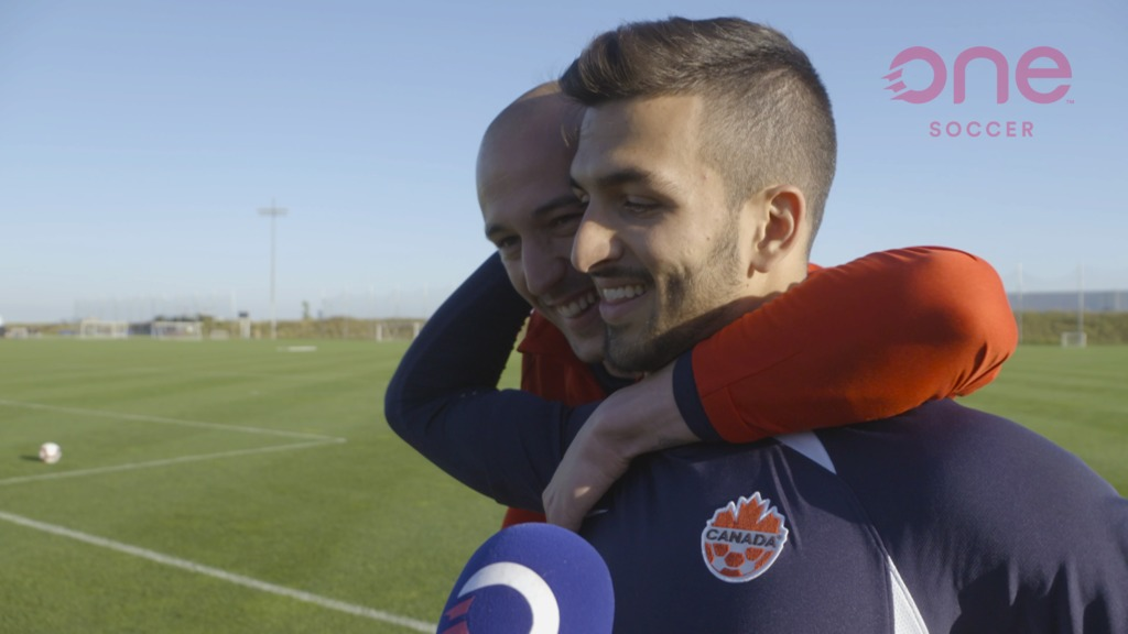 Milan Borjan runs over to distract Marco Carducci during an interview with OneSoccer in Toronto. (Photo: OneSoccer).