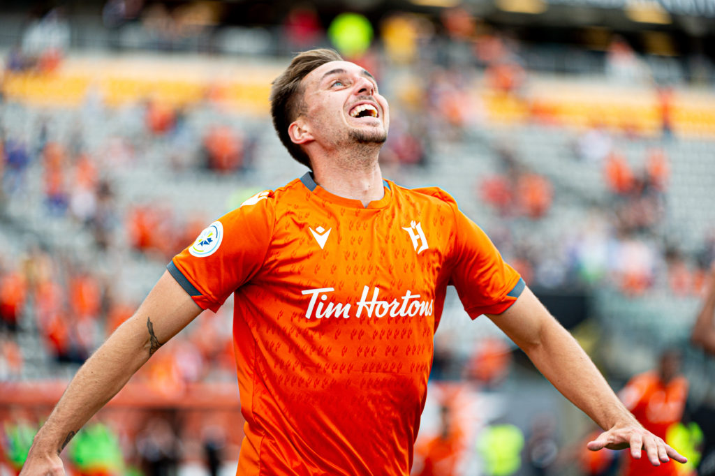 Forge's Marcel Zajac celebrates a game-winning goal against 905 Derby rival York9 FC. (Photo: Ryan McCullough/CPL).