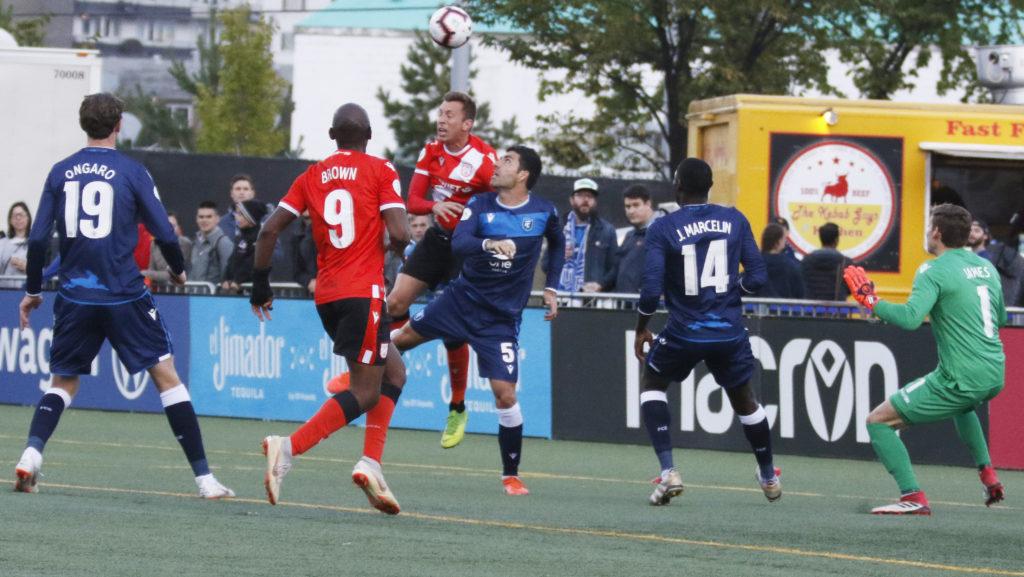 Cavalry FC's Oliver Minatel contests with FC Edmonton's Ramon Soria in the box. (FC Edmonton/CPL).