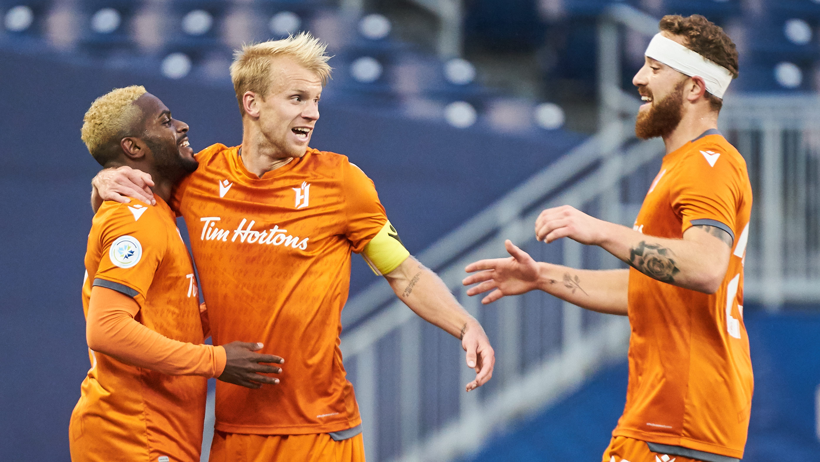 Forge FC's Chris Nanco, Kyle Bekker and Anthony Novak celebrate scoring against Valour FC. (David Lipnowski/CPL)