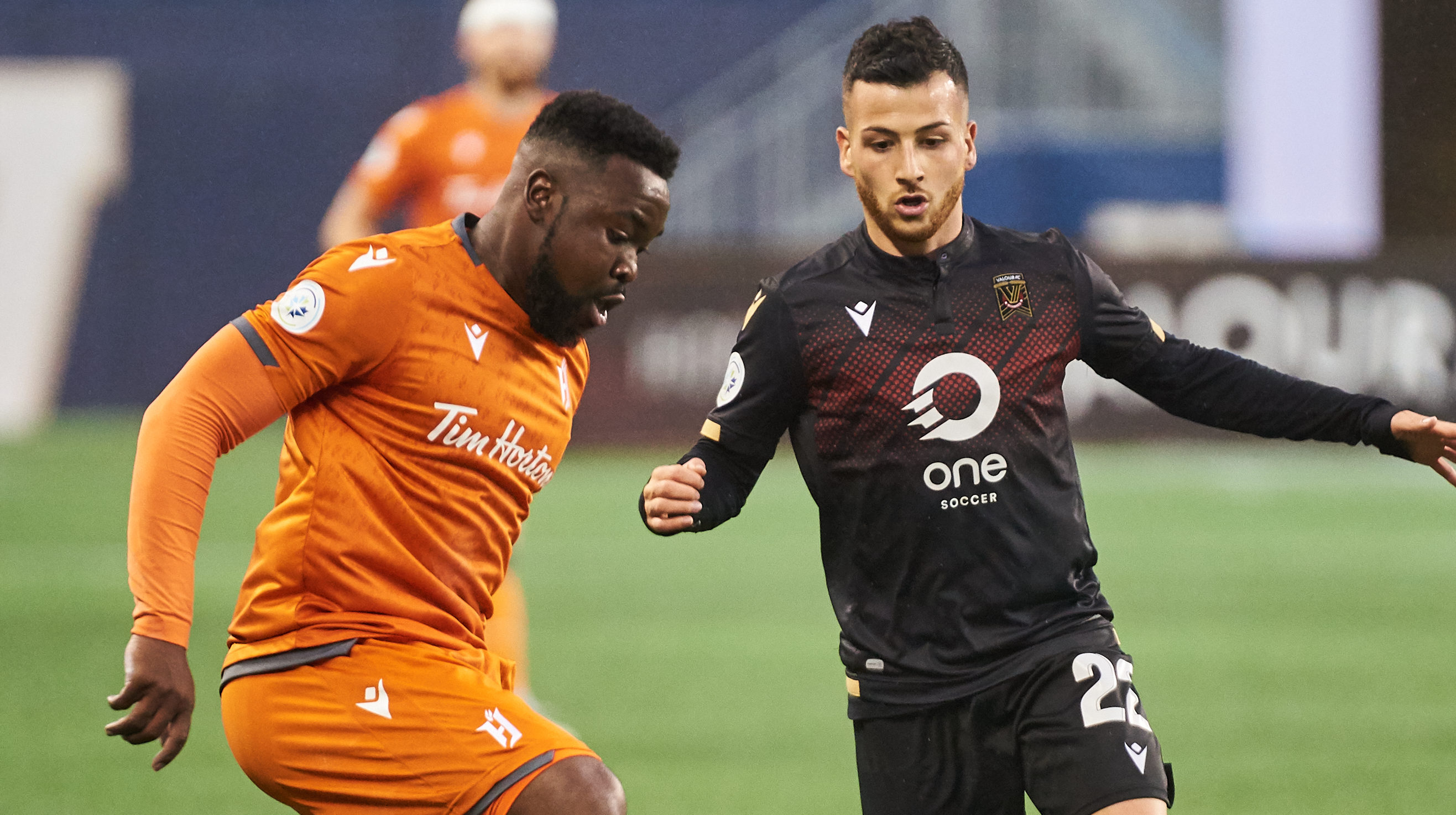 Forge FC's Dominic Samuel and Valour FC's Marco Bustos. (Valour FC/CPL).