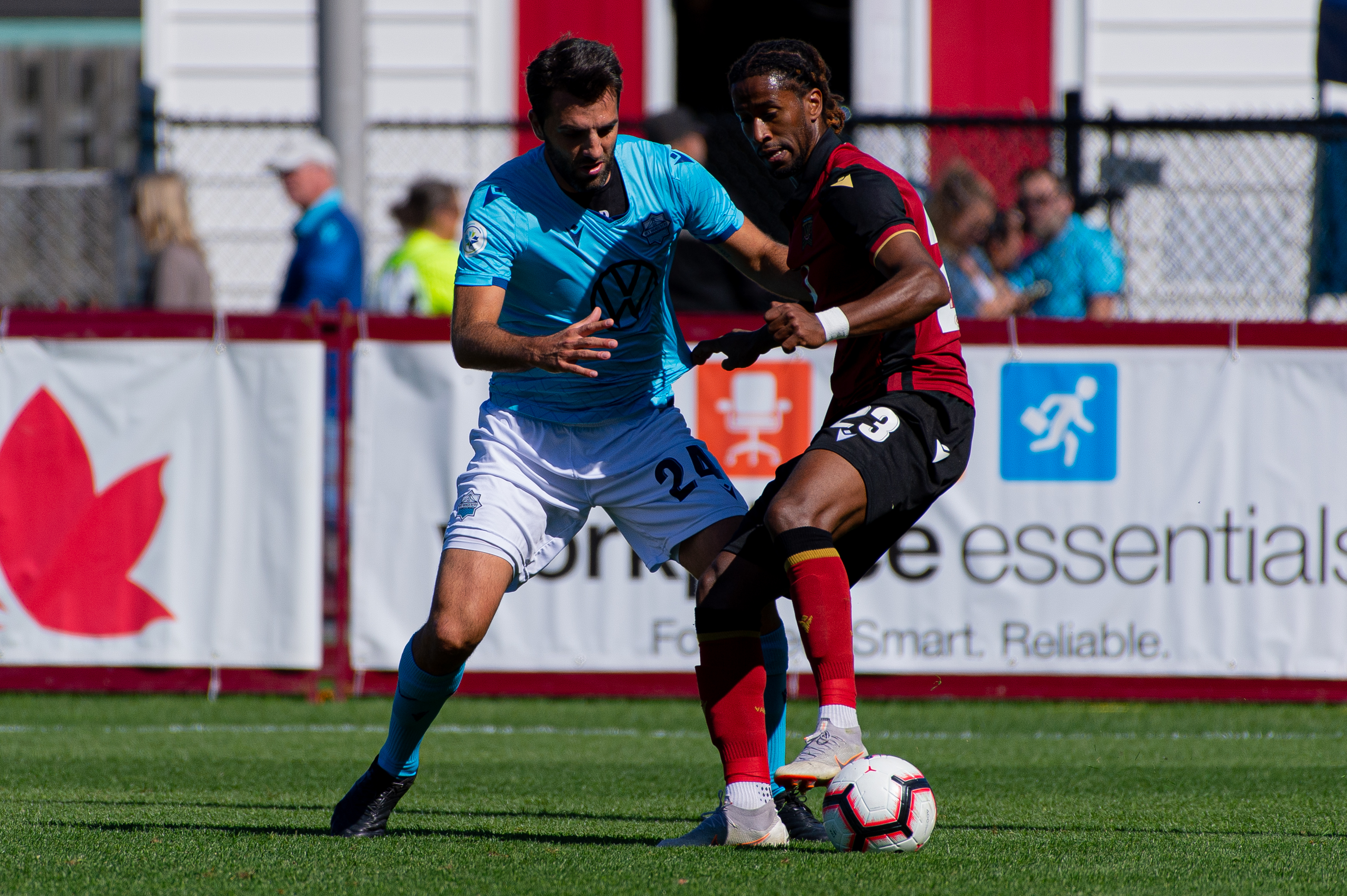HFX Wanderers FC defender Alex De Carolis tries to defend against Valour FC attacker Ali Musse. (Trevor MacMillan/CPL).