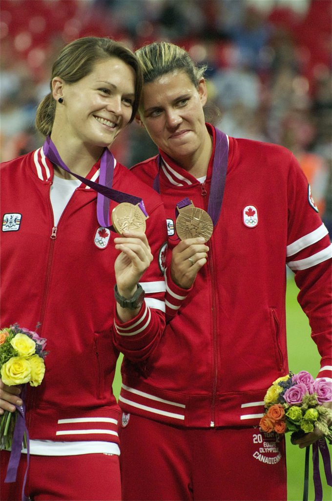 Erin McLeod and Christine Sinclair with their bronze medals at the London 2012 Olympics (Photo: Canada Soccer Les Jones)