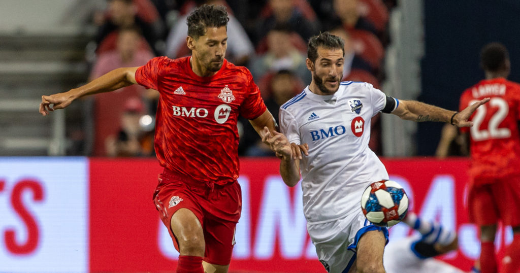 Sep 25, 2019; Toronto, Ontario, Toronto FC defender Omar Gonzalez (44) battles for the ball against Montreal Impact midfielder Ignacio Piatti (10) during the first half at the Canadian Championship at BMO Field. Mandatory Credit: Kevin Sousa-USA TODAY Sports