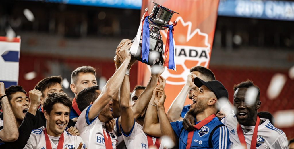 Montreal Impact players hoist the Voyageurs Cup after capturing the 2019 Canadian Championship. (Photo: Nora Stankovic).